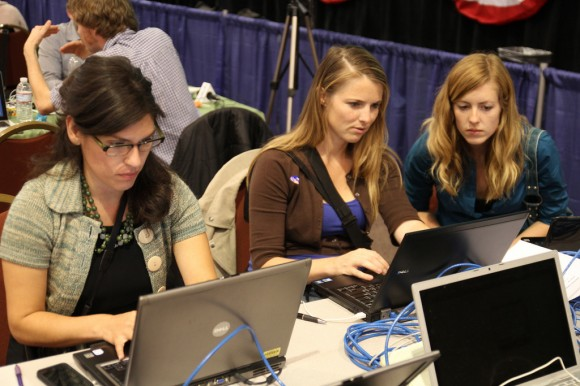 On the right, multimedia journalism students, Christina Maggiora and Andie Adams, work alongside KPBS reporter Ana Tintocalis during election night in San Diego.